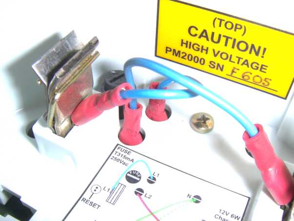 Top view of PM2000 showing wires to be unplugged